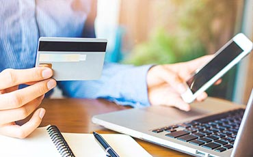 A woman using her credit card on a website