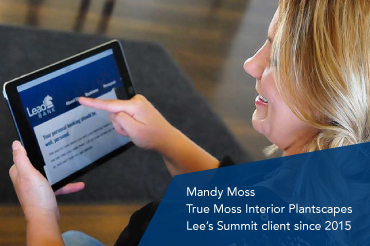 A woman using an ipad to switch to Lead Bank