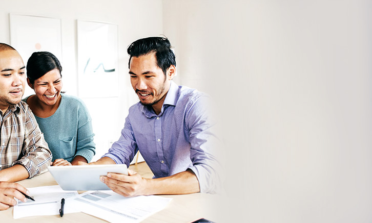 Couple reviewing finances with advisor